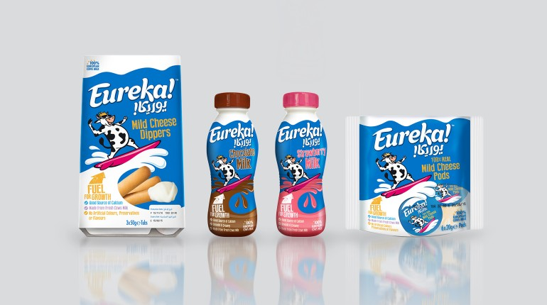Eureka! Dairy product packaging with custom Arabic and English lettering.